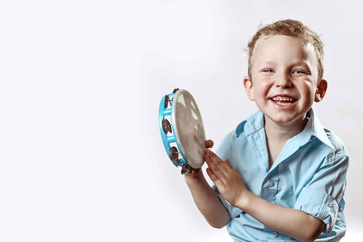 Boy playing tambourine