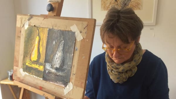 artist working with easel showing work